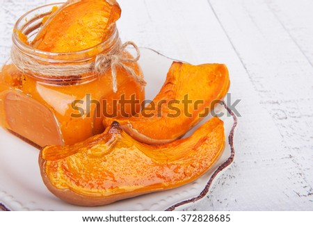 Pieces of roasted pumpkin and pumpkin puree with carrot and apple, baby food diet, on wooden white background - stock photo