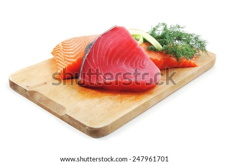 pieces of salmon and tuna fish on wooden plate isolated on white background - stock photo