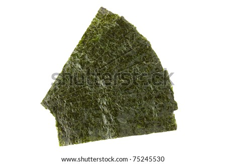 Pieces of seasoned dried seaweed isolated on white - stock photo