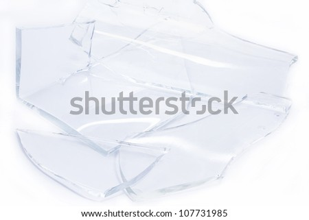 Pieces of smashed glass on white background - stock photo