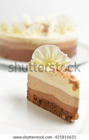 pieces of sponge cake with whipped cream