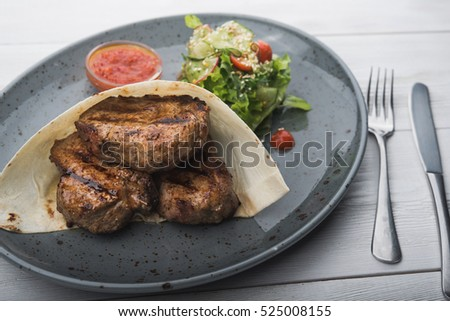 pieces of steak in pita bread. feeding dishes in the restaurant