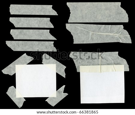 Pieces of sticky paper on black background - stock photo