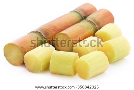 Pieces of sugarcane over white background - stock photo