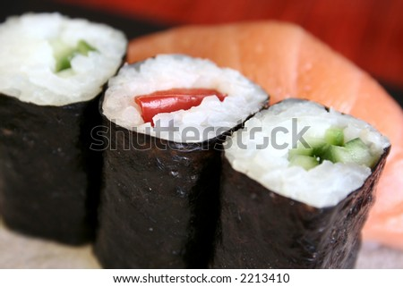 Pieces of  sushi in a row.  Very shallow D.O.F.- Only piece in the middle in focus. - stock photo