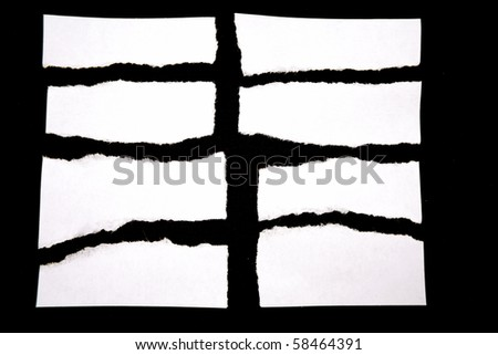 Pieces of torn white paper on black background. Copy space for advertising message - stock photo