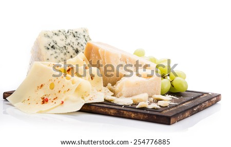 Pieces of various cheeses on white background, close-up. - stock photo