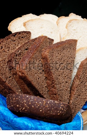 Pieces of white and black bread with selective focus