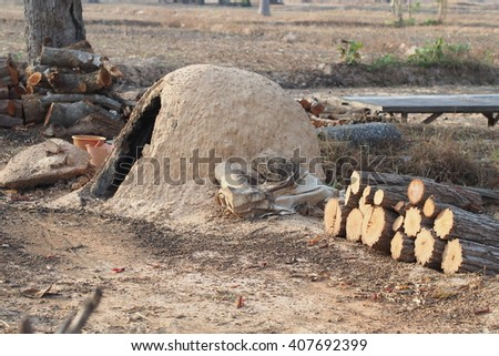 Pieces of wood prepare for making charcoal in rural of Thailand - stock photo