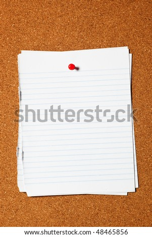 Pieces of writing paper pinned on corkboard