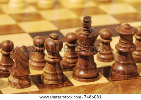 Pieces on a chess board - stock photo