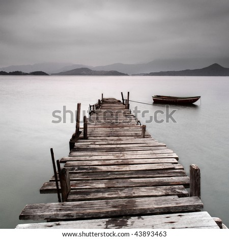 pier and boat, low saturation - stock photo
