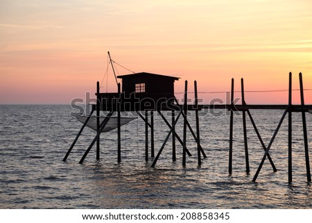Pier and cabins for fishing in the atlantic ocean near La Rochelle in France - stock photo