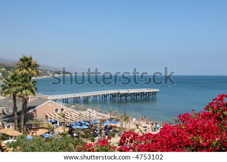 Pier and resort on the Pacific Ocean. - stock photo