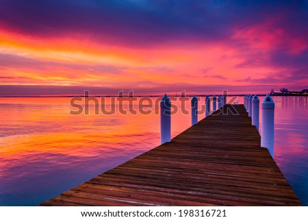 Pier and sunset over the Chesapeake Bay, seen from Kent Island, Maryland. - stock photo