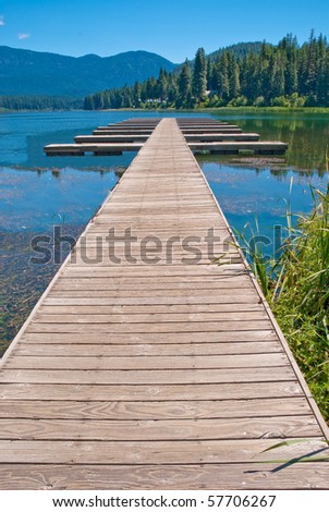 Pier and the lake. - stock photo