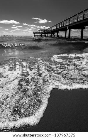 Pier and the Shoreline - stock photo