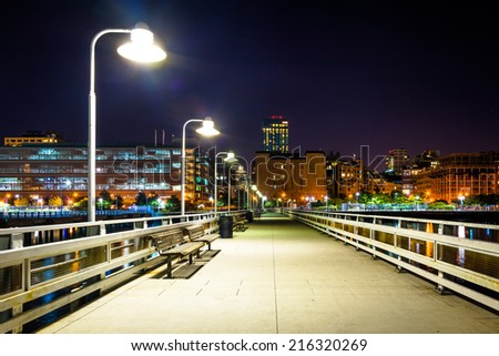 Pier 34 at night, on the Hudson River in Manhattan, New York. - stock photo