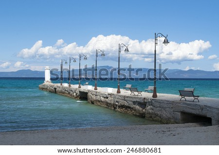 Pier at sunny day in Pefkohori, Greece - stock photo
