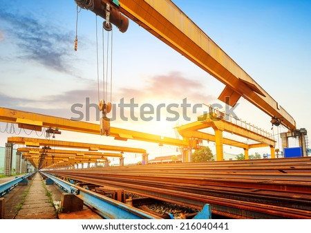 Pier bridge crane and cargo handling, cargo trains transported away. - stock photo