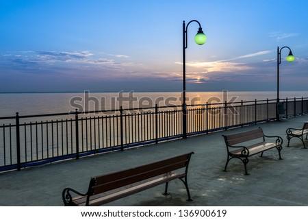 Pier during sundown in Miedzyzdroje, Poland, Baltic sea - stock photo