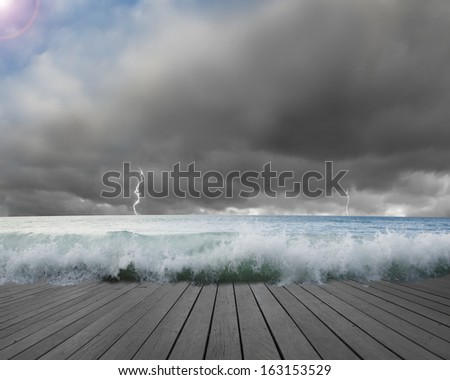 Pier flooded by waves with cloudy sky, Lightning in dangerous situation - stock photo