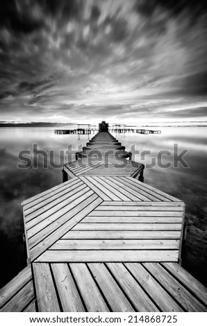 Pier in black and white  - stock photo