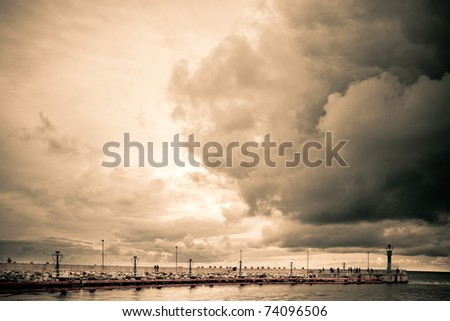 Pier in Poland before the storm,  sepia version - stock photo