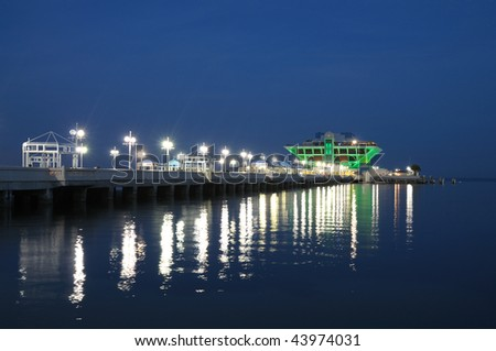 Pier in St. Petersburg illuminated at night. Florida USA - stock photo