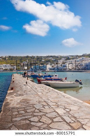 pier in the harbor of Mykonos with fishing boats. - stock photo