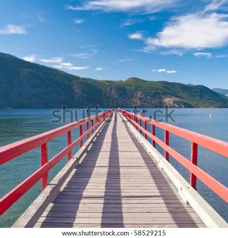 Pier in the morning sunlight. - stock photo