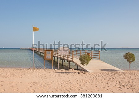 Pier in the sea in cloudless weather