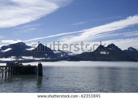Pier in Valdez Harbor  with mountain landscape - stock photo