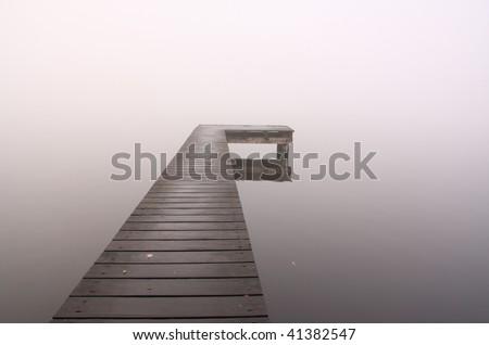 Pier into the fog - stock photo