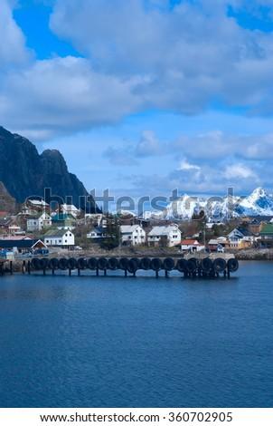 Pier of town Svolvaer on Lofoten islands in sunny day - stock photo