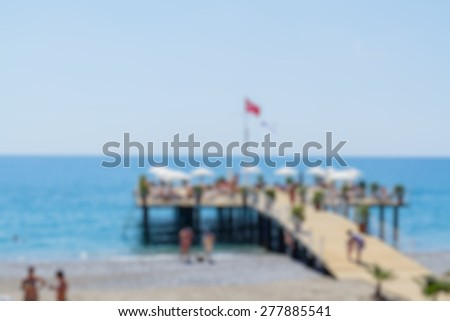 pier on sea abstract blur background - stock photo