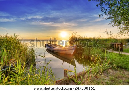 pier on the lake at sunrise - stock photo