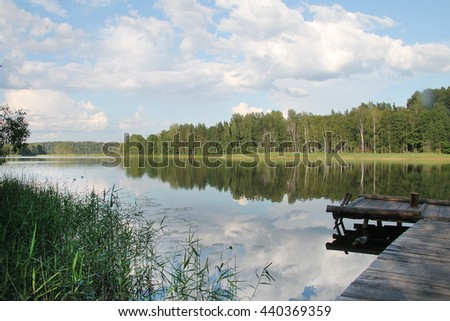 Pier on the lake overlooking the wood