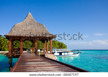 Pier on the tropical island of Maldives - stock photo