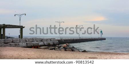 Pier out into Lake Ontario at Oshawa Ontario in December - stock photo