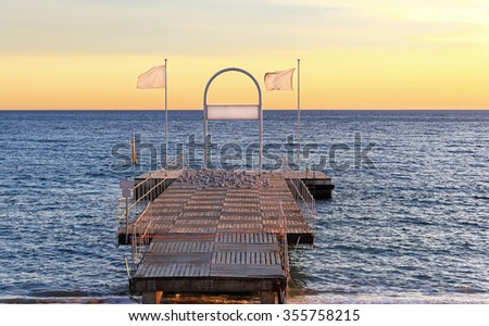Pier platform at French riviera in Cannes - stock photo