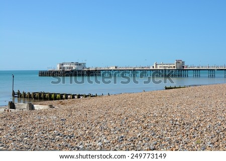 Pier, seafront and beach at Worthing, West Sussex, England.