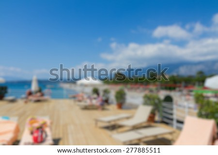 pier view sea and beach abstract blur background - stock photo