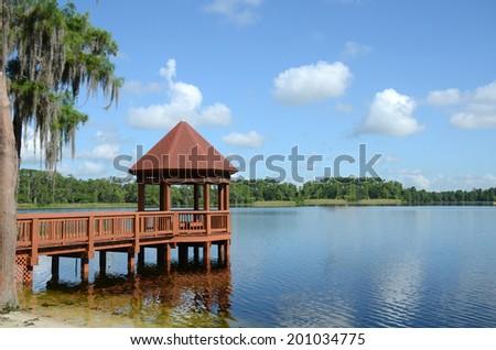 pier with gazebo on lake - stock photo