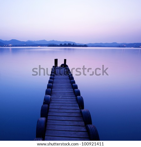 pier with sunset - stock photo