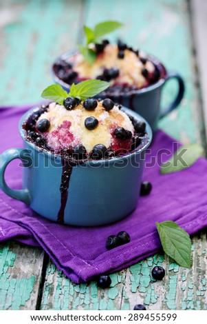 Pies with blueberries and mint in a cup - stock photo