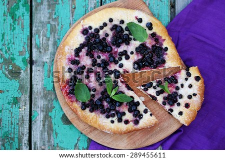 Pies with blueberries and mint, top view - stock photo