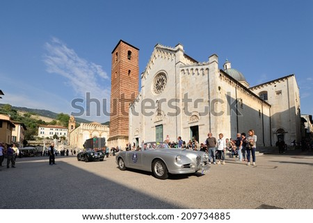 PIETRASANTA, ITALY - APRIL 26: A gray Alfa Romeo CCS and a green Jagaur XK140 take part to the GP Terre di Canossa classic car race on April 26, 2014 in Pietrasanta. Cars were built in 1957 and 1954. - stock photo
