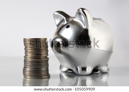 pig bank and stack of coins isolated on white background - stock photo