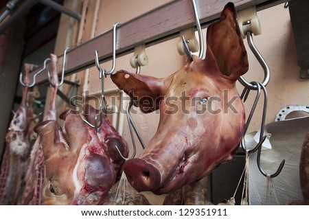 pig cut head in a meat market - stock photo